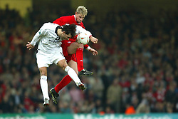 CARDIFF, WALES - Sunday, March 2, 2003: Liverpool's Stephane Henchoz and Manchester United's Ruud van Nistlerooy during the Football League Cup Final at the Millennium Stadium. (Pic by David Rawcliffe/Propaganda)