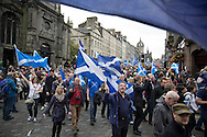Crowds marching down the Royal Mile during a pro-Independence march and rally in the Scottish capital. The event, which was staged in support of the pro-Independence movement, was attended by an estimated by approximately 30,000 people. The referendum to decide whether Scotland will become an independent nation will be staged on 18th September 2014.