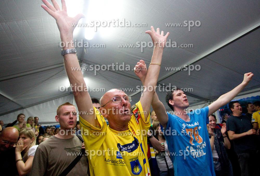 Fans of Cimos Koper celebrate  after the handball match between RK Cimos Koper (SLO) and SL Benfica (POR) in return final match of EHF Challenge Cup, on May 22, 2011 in Tent at Arena Bonifika, Koper, Slovenia. Koper defeated Benfica 31-27 and became Euro Challenge Champion 2011. (Photo By Vid Ponikvar / Sportida.com)