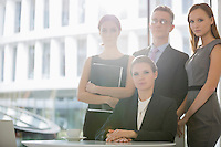 Portrait of confident business team in office cafeteria