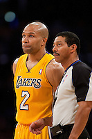 20 April 2011: Guard Derek Fisher of the Los Angeles Lakers argues a call with NBA official Bill Kennedy while playing against the New Orleans Hornets during the first half of the Lakers 87-78 victory over the Hornets in Game 2 of the first round of the NBA Western Conference Playoffs at the STAPLES Center in Los Angeles, CA.