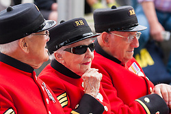 London, June 23rd 2014. Chelsea Pensioners are  among those attending as members and veterans of the military gather at City Hall for a flag raising ceremony to mark Armed Forces Day