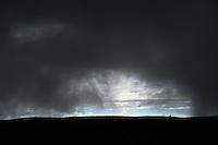 Rain clouds clearing up on Sprengisandur mountain road in Iceland. Car and people (small) on horizon. Regnskýin að leysast upp á Sprenigsandi. Bíll og fólk sjást við sjóndeildarhringinn.