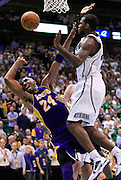 Los Angeles Lakers guard Kobe Bryant (24) is fouled by Utah Jazz forward Paul Millsap, right, during the second half of Game 4 of the NBA Western Conference second-round playoff series in Salt Lake City, Monday, May 10, 2010. (AP Photo/Colin E Braley)
