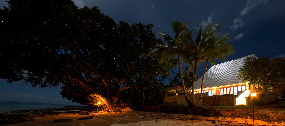 Exterior Shot of a Private Hotel Bungalow on the Beach at Night, Fiji