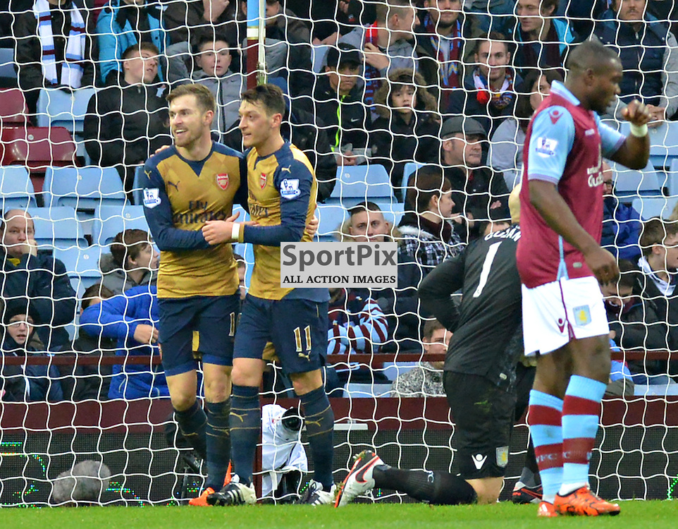 Mesut Ozil congratulates team mate Aaron Ramsey after he had put the Gunners 2-0 up at Villa Park......(c) BILLY WHITE | SportPix.org.uk