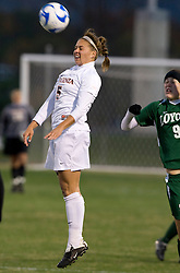Virginia midfielder/forward Shannon Foley (5) leaps for a header.  The Virginia Cavaliers defeated the Loyola (MD) Greyhounds 4-1 in the first round of the NCAA Women's Soccer tournament held at Klockner Stadium in Charlottesville, VA on November 16, 2007.