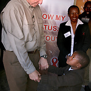 July 13, 2006 - Six-year-old Arriet, who is HIV positive, healthy, and on ARV's, dances with President Clinton as he visits the antiretroviral treatment center, Karabong Clinic, at Mafeteng Hospital in Lesotho. Arriet was among the first group of children to receive ARV treatment donated by the Clinton Foundation in 2004. Phto by Evelyn Hockstein