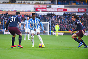 Adama Diakhaby of Huddersfield Town (11) takes on Sead Kolasinac of Arsenal (31) and Matteo Guendouzi of Arsenal (29) during the Premier League match between Huddersfield Town and Arsenal at the John Smiths Stadium, Huddersfield, England on 9 February 2019.