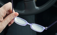 Putting on glasses for driving car