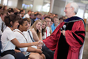 Ohio University College of Business Dean Hugh Sherman addresses incoming freshmen during the College of Business Freshman Convocation at Nelson Commons on Aug. 23, 2014. Photo by Lauren Pond.