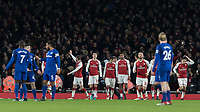 Football - 2017 / 2018 Premier League - Arsenal vs. Everton<br /> <br /> Arsenal players walk back to their half after congratulating Aaron Ramsey (Arsenal FC) on his third goal at The Emirates.<br /> <br /> COLORSPORT/DANIEL BEARHAM