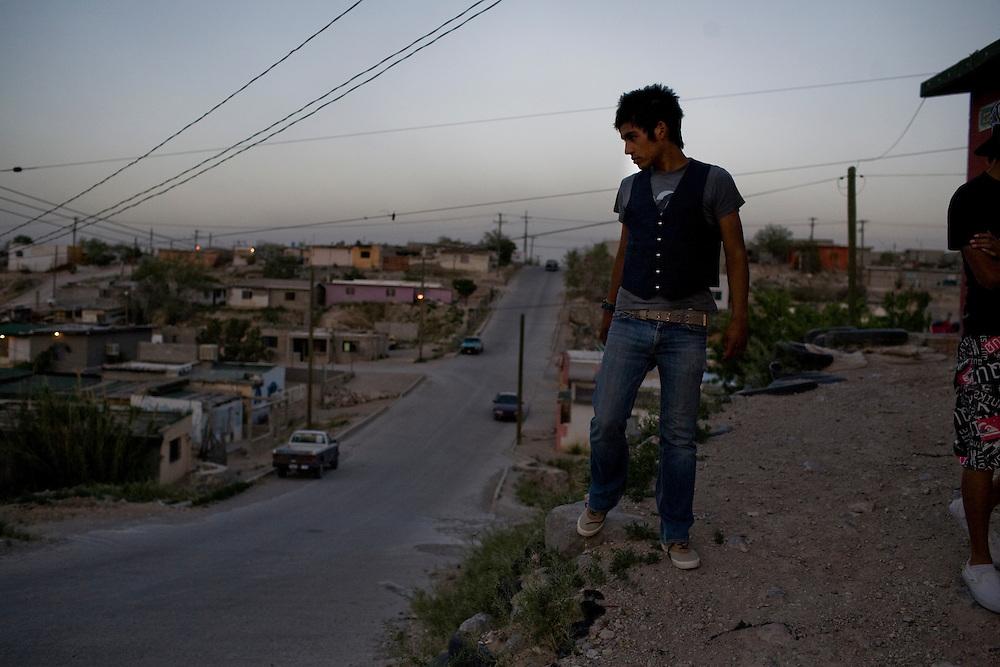 Juan Manuel Delgado, 18, hangs out in the Diaz Ordaz colonia in Ciudad Juarez, Chihuahua Mexico on April 28, 2010.