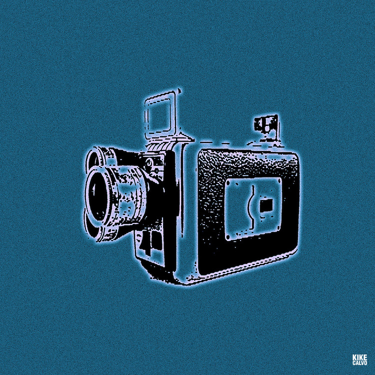 Vintage super 8 video camera on blue background