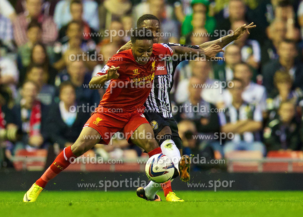 27.08.2013, Anfield, Liverpool, ENG, League Cup, FC Liverpool vs Notts County FC, 2. Runde, im Bild Liverpool's Raheem Sterling and Notts County's Jamal Campbell-Ryce during the English League Cup 2nd round match between Liverpool FC and Notts County FC, at Anfield, Liverpool, Great Britain on 2013/08/27. EXPA Pictures &copy; 2013, PhotoCredit: EXPA/ Propagandaphoto/ David Rawcliffe<br /> <br /> ***** ATTENTION - OUT OF ENG, GBR, UK *****