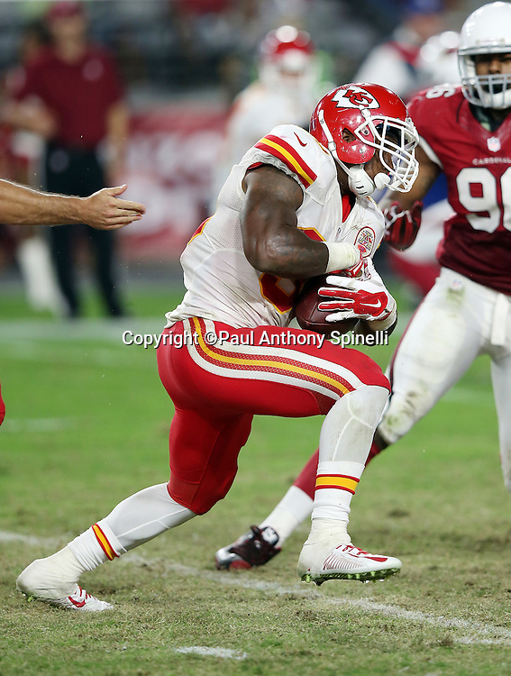 Kansas City Chiefs fullback Spencer Ware (30) runs the ball in the fourth quarter during the 2015 NFL preseason football game against the Arizona Cardinals on Saturday, Aug. 15, 2015 in Glendale, Ariz. The Chiefs won the game 34-19. (©Paul Anthony Spinelli)