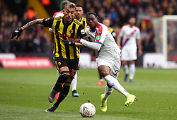 Watford's Roberto Pereyra (left) and Crystal Palace's Aaron Wan-Bissaka battle for the ball during the FA Cup quarter final match at Vicarage Road, Watford.