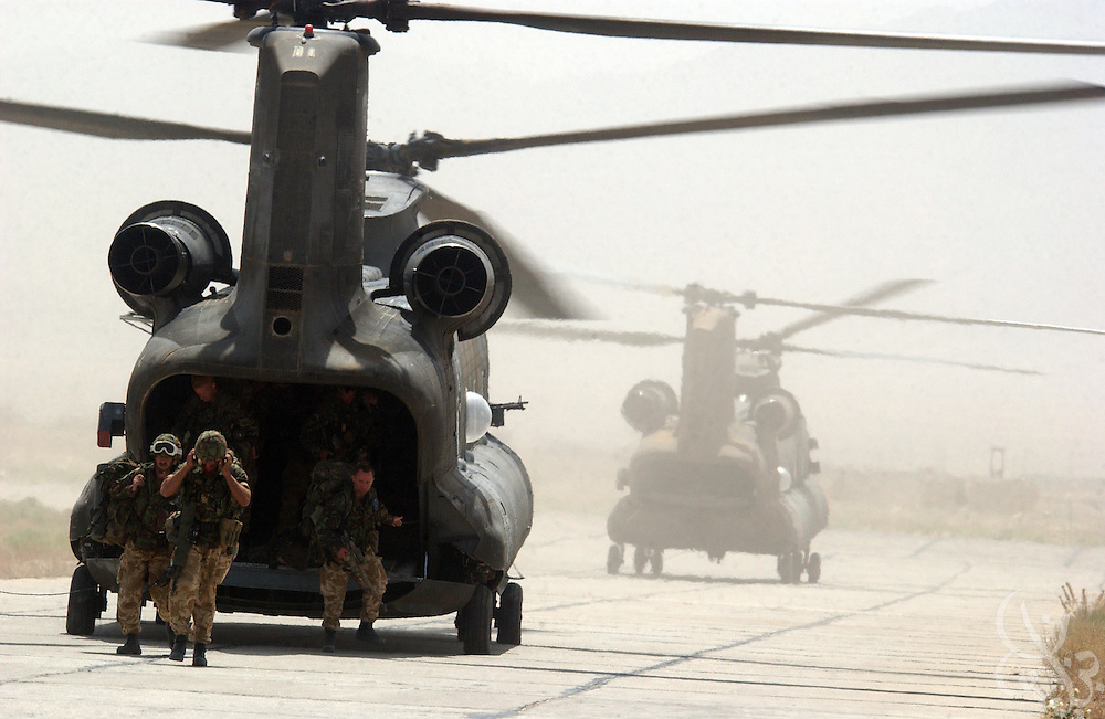 """British Operation Buzzard officially ends as Royal Marines of 45 Commando """"Yankee"""" company return to Bagram airbase on July 9, 2002 from their mission in South Eastern Afghanistan. Operation Buzzard was the last planned combat mission for the British forces, who are expected to complete their troop pullout from Afghanistan later this month."""