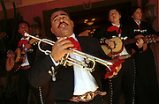 05 MAY 2002 - SCOTTSDALE, ARIZONA, USA: Members of the Mariachi group Alma del Sol (Soul of the Sun) perform before 1st Annual Running of the Bulls at Rawhide in Scottsdale, Arizona, Sunday, May 5, 2002. The event was a part of a Cinco de Mayo celebration. About 400  people paid up to $80 each to run with the bulls. The event was fashioned after the running of the bulls in Pamplona, Spain. .PHOTO BY JACK KURTZ