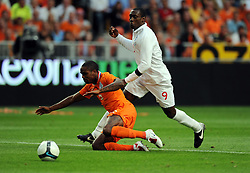 Edson Braafheid of Holland and Emile Heskey of  England during the International Friendly between Netherlands and England at the Amsterdam Arena on August 12, 2009 in Amsterdam, Netherlands.