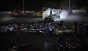 "Competitors and pit crews watch the popular  ""Hit to Pass"" race at Agassiz Speedway in Agassiz, BC (2012)"