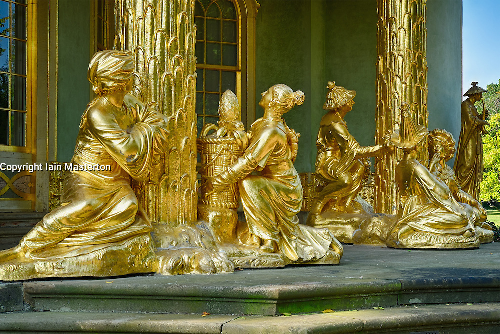 Golden statues in the Chinese Teahouse at Sanssouci Gardens Potsdam , Berlin, Germany  a UNESCO World Heritage site