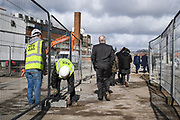 AFC Wimbledon legend Ian Cooke, Chief Executive Erik Samuelson, Council Leader Stephen Alambritis, AFC Wimbledon legend Dave Bassett and other AFC Wimbledon staff make their way to watch the demolition event, marking the start of building works at the AFC Wimbledon Stadium Site, Plough Lane, United Kingdom on 16 March 2018. Picture by Stephen Wright.