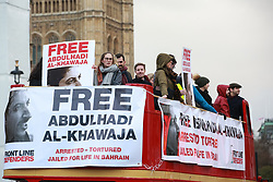 London, UK. 3rd December, 2018. Campaigners from Front Line Defenders tour Parliament Square on a double-decker bus to call for the release of Abdulhadi Al-Khawaja, a human rights defender currently serving a life sentence for his work in Bahrain.