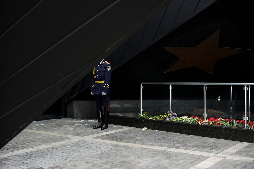 A Ukrainian policeman stands guard during V-Day commemorations in Donetsk.