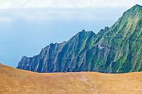 The edge of the Pihea Trail overlooking the Kalalau Valley and the Pacific Ocean on the Na Pali Coast of Kauai, Hawaii, USA.