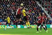 Simon Francis (2) of AFC Bournemouth battles for possession with Troy Deeney (9) of Watford during the Premier League match between Bournemouth and Watford at the Vitality Stadium, Bournemouth, England on 12 January 2020.