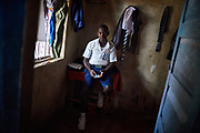 Amidu Koroma, 18 years old at the family home in Kenema, Kenema District, Sierra Leone on June 3, 2017. His mother Kadiatu died two weeks before of malaria. When Kadiatu fell ill, her condition wasn&rsquo;t serious so they tried to look after her at home. After three days though, her condition worsened so they decided to take her to hospital. Mariama was diagnosed with severe malaria at the hospital but she didn&rsquo;t survive. <br /> <br /> &ldquo;My mother&rsquo;s death is affecting me a lot because she was the one providing most of my schooling needs such as paying for fees. I am trying to be ok but it is not easy. I have even been driven away from school because I owe school fees that we cannot pay. I am not sure how I am going to get money to support myself and meet my school needs. I want to be lawyer after I complete school but I wonder if that will happen without my mother.&rdquo; said Amidu.