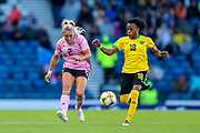 Kirsty Smith (#2) of Scotland plays a pass under pressure from Trudi Carter (#18) of Jamaica during the International Friendly match between Scotland Women and Jamaica Women at Hampden Park, Glasgow, United Kingdom on 28 May 2019.