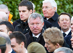 © under license to London News Pictures. 26/1/2011, Sir Alex Ferguson (centre) arriving at the  funeral of Bolton Wonderers and England star, Nat Lofthouse at Bolton Parish Church today (26/01/2011)Nat  died at the age of 85. Photo credit should read:Joel Goodman/LNP