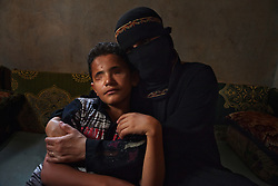 "Saleem al Harazi, who lost both eyes to a sniper, is cradled by his mother in Sana, Yemen, March 26, 2012. The 12-year-old was shot when he joined antigovernment protesters in Sana in March 2011. ""I loved them and wanted to stand with them,"" he recalls. ""I wanted them to end poverty."" They were the last people he ever saw, and he has no regrets: ""I am still happy I was able to witness the protests firsthand."""