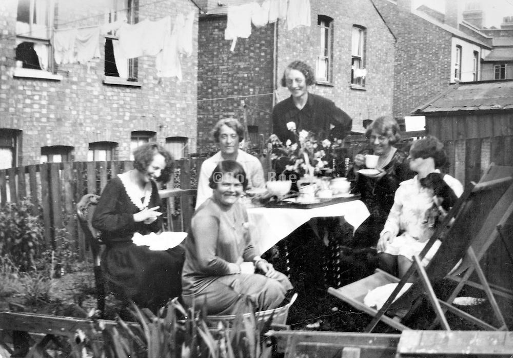 female group gathering in backyard England
