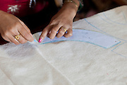 Measuring the pattern for clothing at Womens Skills Development Project in Pokhara, Nepal. The WSDP was set up in 1975 as a non-profit, fair trade organization to help disadvantaged women in Nepal.