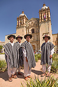 Traditional costumed male Istmo folk dancers stand outside the Santo Domingo church during the Day of the Dead Festival known in spanish as Día de Muertos on October 26, 2014 in Oaxaca, Mexico.