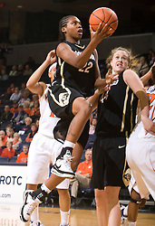 Colorado forward Brittany Spears (22) leaps for a layup against UVA.  The #16 ranked Virginia Cavaliers women's basketball team defeated the Colorado Buffaloes 77-43 at the John Paul Jones Arena on the Grounds of the University of Virginia in Charlottesville, VA on November 24, 2008.