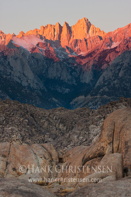 Light from the rising sun creeps down the face of Mt. Whitney at dawn, Alabama Hills, CA