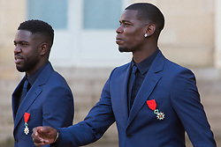 France's national Samuel Umtiti and Paul Pogba leaves after receiving the Legion of Honour during a ceremony to award French 2018 football World Cup winners, on June 4, 2019, at the Elysee Palace in Paris. Photo by Raphael Lafargue/ABACAPRESS.COM