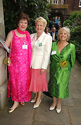 Left to right, MRS KEITH SIMPSON, LADY GRIFFITHS and LADY BRENNAN at the annual Macmillan Cancer Support House of Lords vs the House of Commons Tug of War held in Victoria Tower Gardens on 20th June 2006.<br />