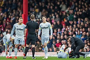 Martyn Waghorn (Derby County) & Tom Lawrence (Derby County) talking with John Brooks (Referee) during the EFL Sky Bet Championship match between Brentford and Derby County at Griffin Park, London, England on 6 April 2019.