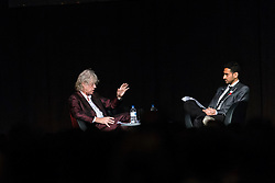 © Licensed to London News Pictures. 24/07/2014. Musician and Campaigner Sir Bob Geldof (left) is interviewed by Waleed Aly (right) speaks during a session of the 20th International AIDS conference held in Melbourne Australia. Photo credit : Asanka Brendon Ratnayake/LNP