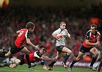 Photo: Rich Eaton.<br /> <br /> Wales v Canada. Invesco Perpetual Series. 17/11/2006. Shane Williams centre of Wales leaves the Canadian defence in his wake l-r Morgan Williams,  Sean-Michael  Stephen and Ryan Smith