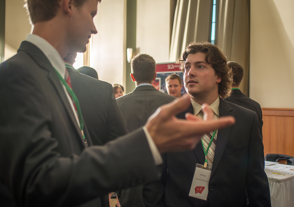Robert Lambert, left, and Max Novak, right, stand in line to speak to a potential employer at the Ohio Univeristy Sports Administration Career Fair in the Walter Hall Rotunda. Photo by Elizabeth Held