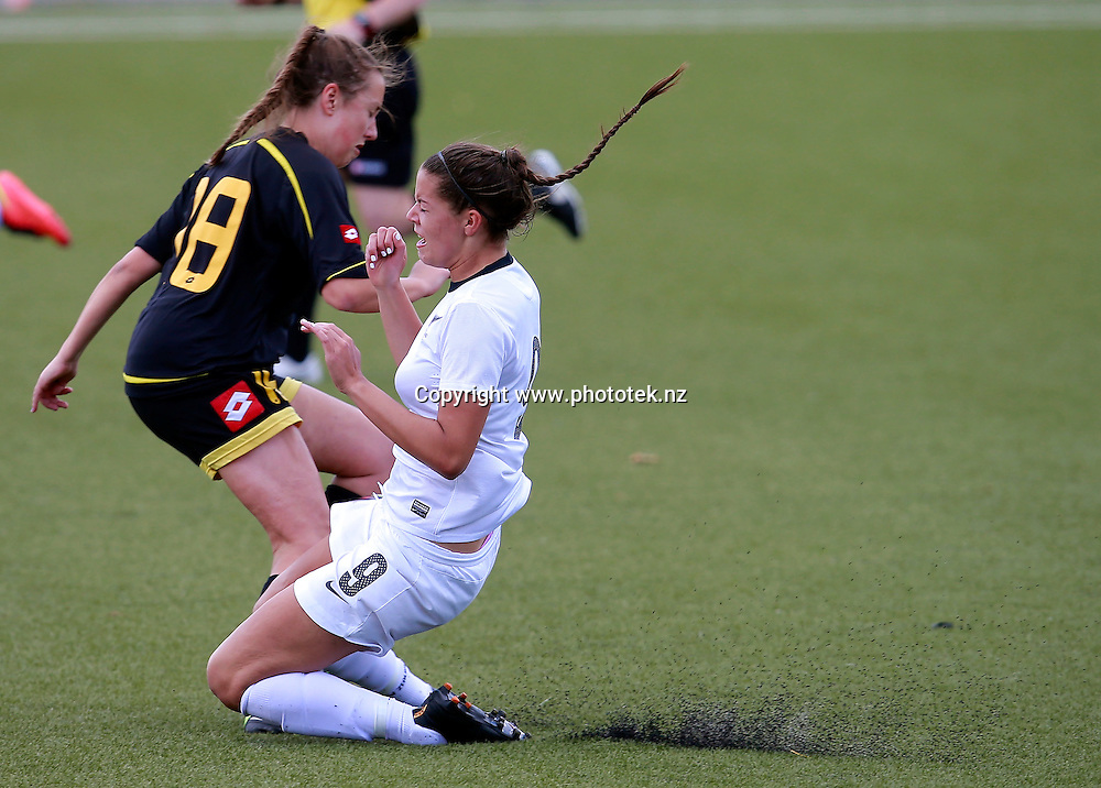 NZF's Martine Puketapu collides with Capital's Ellen Fibbes. ASB Womens League Preliminary Final, NZF Development v Capital Football, QBE Stadium, Auckland, Sunday 30th November 2014. Photo: Shane Wenzlick