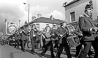 Flute band heads an Orange lodge leaving Sandy Row, Belfast, N Ireland, to join up with the main parade going to The Field at Edenderry on the outskirts of Belfast. 197407120389b<br />