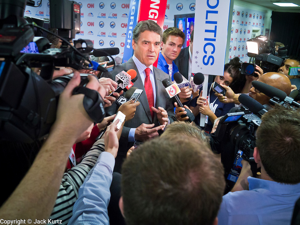 "22 FEBRUARY 2012 - MESA, AZ:  Texas Governor (and former Presidential candidate) RICK PERRY talks about Newt Gingrich's performance in the Arizona Republican Presidential Debate in the ""Spin Room"" at Mesa Arts Center Wednesday night. Perry is endorsing Gingrich. Some of the candidates and their representatives visited the ""Spin Room"" after the debate to discuss how well their candidates did in the two hour debate, the last one before the Arizona and Michigan primaries next week and ""Super Tuesday"" on March 6.    PHOTO BY JACK KURTZ"