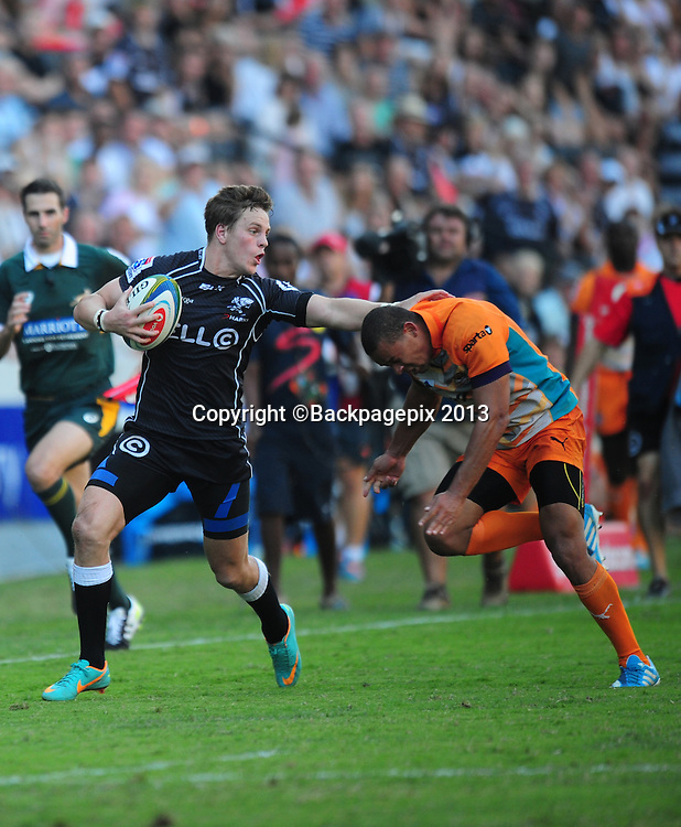 Sp Marias of the Sharks tackling Willie Le Roux of the Cheetahs during the 2014 Super Rugby Sharks match between Sharks and Cheetahs at the Kings Parks Stadium in Durban , Kwa-Zulu Natal on the 19th of April 2014<br /> <br /> &copy;Sabelo Mngoma/BackpagePix